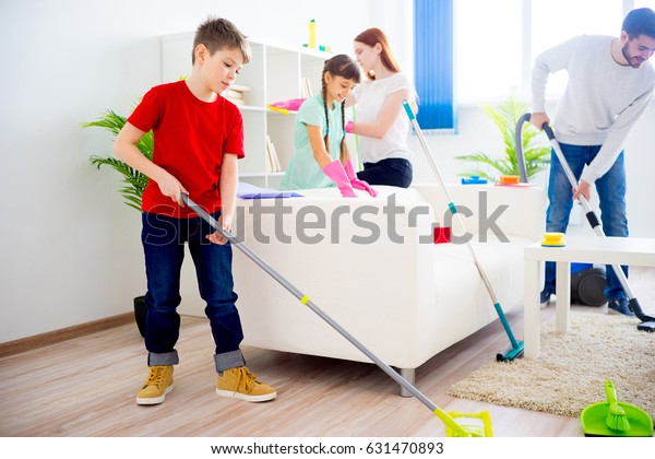 Family cleaning house