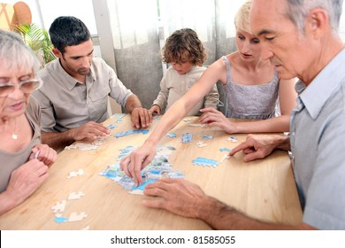 Family completing jigsaw together