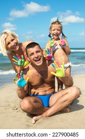 Family concept. Happy family of three having fun at the beach