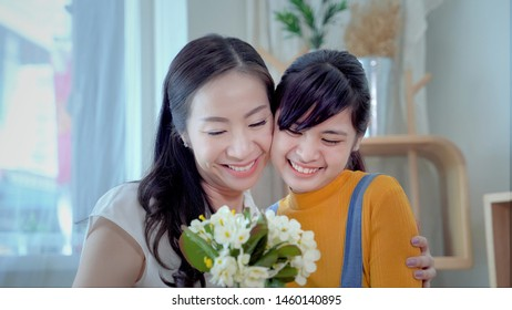 Family concept, mother and daughter are showing love each other by hugging. South East Asian families