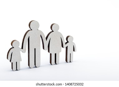Family concept. Wooden figures on bright background.