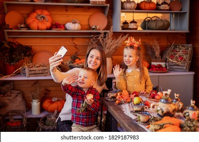 Family congratulates friends on Thanksgiving online. Video chatting with friends new normal. Festive dinner remotely by phone on a smartphone. Social distance pandemic covid-19. Celebrating tradition