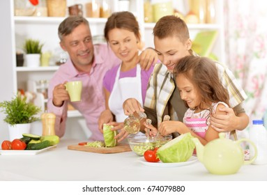 family cooking salad