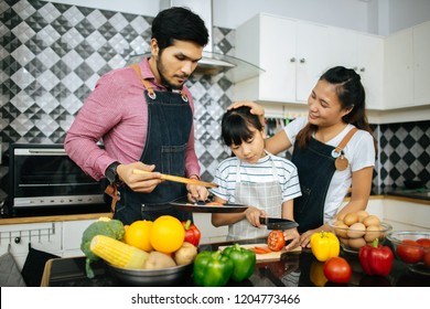 Family cooking time : Happy family help cooking meal together in kitchen at home.