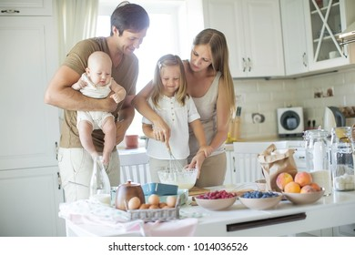 The family cooks in the kitchen