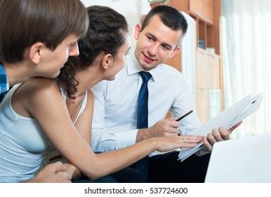 Family couple and insurance agent discussing possibility of mortgage