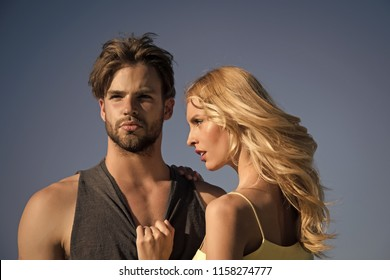 family or couple in love of blonde sexy woman and young muscular man on sunny summer blue sky background, love and romance, future