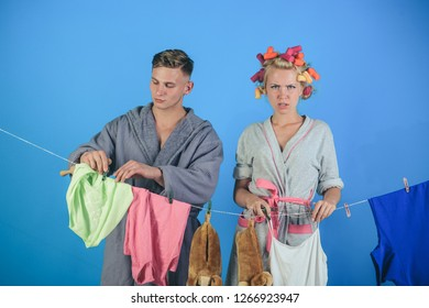 family couple. retro housewife. Maid or housewife cares about house. Man and woman. Love. Vintage housekeeper woman. Multitasking mom. Performing Different Household Duties. Unhappy glance.