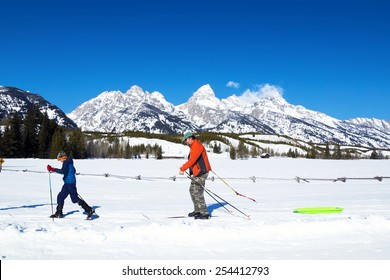 Family Cross-country skiing in Grand Teton National Park, Wyoming, USA