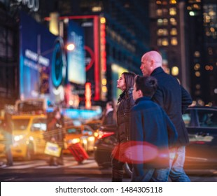 Family crossing street in New York's Time Square