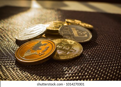 Family of cryptocurrency. Stack of shining golden and silver coins with sunlight on background. Crypto group. Ripple and litecoin dominance, Warm colours - photo of crypto coins.