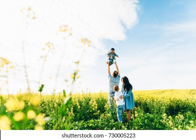 Family Dad Mom and Children in the Field