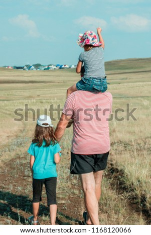 2fe6c11d58 Family Dad Two Daughters Walking Along Stock Photo (Edit Now ...
