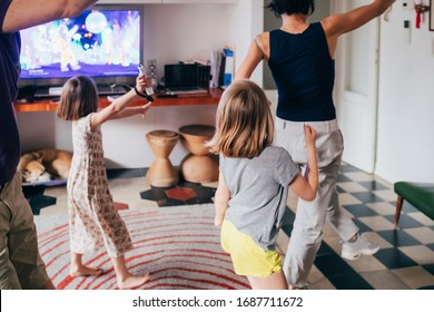 Family dancing together indoor playing videogame - healthy lifestyle, togetherness, playing concept