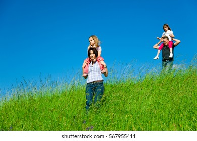 Family Desceding A Hill