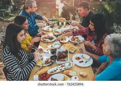 Family dining outdoor at backyard patio