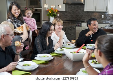 a family dinner / the family interaction / that is happening