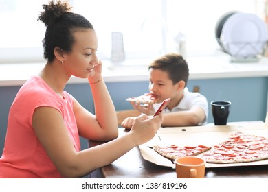 Family dinner. People eating pizza at home