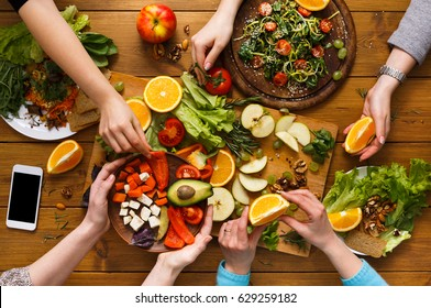 Family dinner table. Women at home together, eat healthy food, top view, flat lay, crop