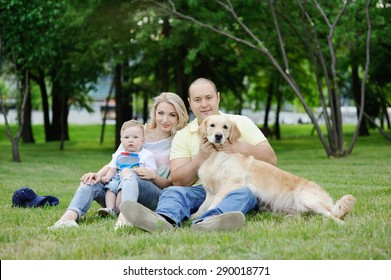 family with a dog retriever on the grass