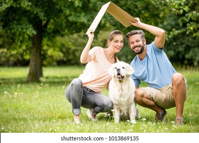 Family with dog and roof as home or building construction concept