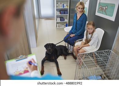 Family with dog at the vet