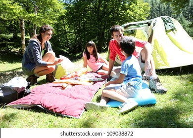 Family doing camping in the forest