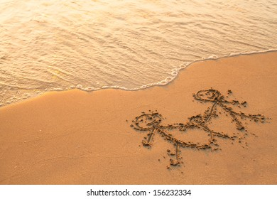 Family drawing on sea sand.