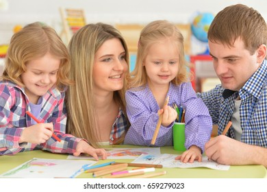family drawing pictures together