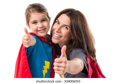 Family dressed like superhero with thumb up