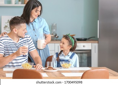 Family drinking milk during breakfast at home