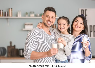 Family drinking milk at home