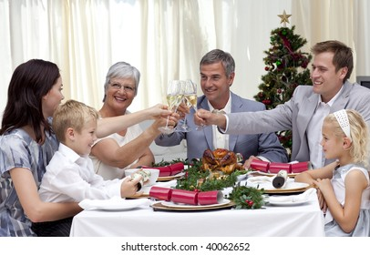 Family drinking a toast in a Christmas dinner at home