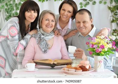 family drinks tea