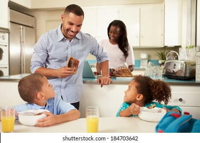 Family Eating Breakfast At Home Together