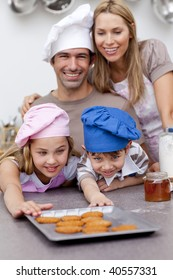 Family eating cookies after baking in the kitchen
