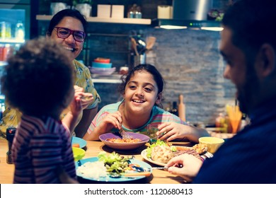 Family eating at the dining table together
