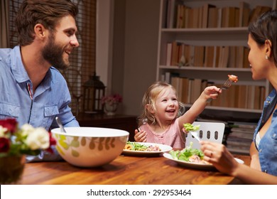 Family eating an dinner at a dining table