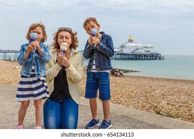 Family eating ice cream in Eastbourne, UK