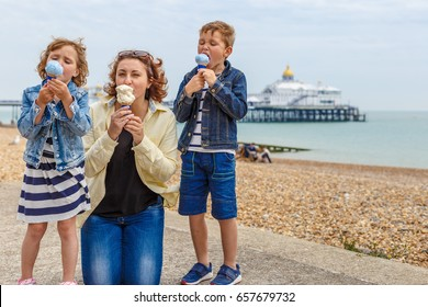 Family eating ice cream in Eastbourne, UK