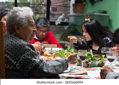 family eating and talking at a Christmas dinner