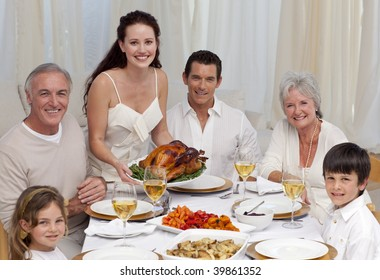 Family eating turkey in a dinner at home