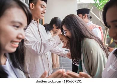 family embracing each other during eid mubarak celebration. Forgiving