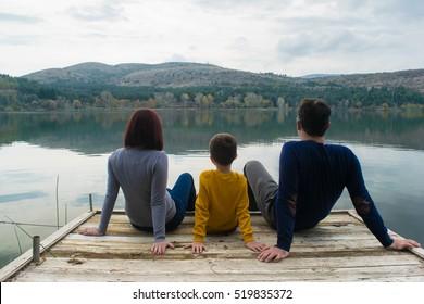 Family enjoying autumn by the lake