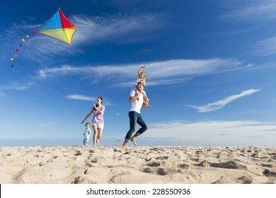 Family Enjoying a Day on the Beach Flying a Kite