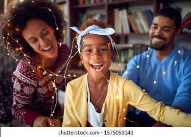 Family enjoying on winter holiday.happy African American family celebrate Christmas together