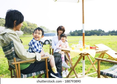 family enjoying picnic in prairie