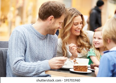 Family Enjoying Snack In Cafe Together