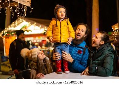 Family enjoying traditional Christmas market in Zagreb, Croatia.