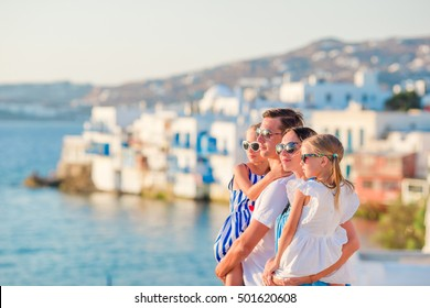 Family In Europe Parents And Kids On Little Venice Background Mykonos Island